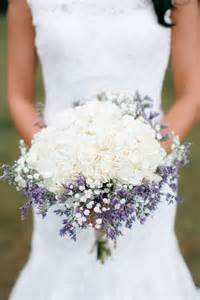 ohio barn wedding carried a rustic biedermeir style bouquet composed of hydrangeas babys breath and lavender