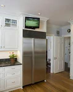kitchen glass cabinets glass front ivory kitchen cabinets are mounted above ivory 1766