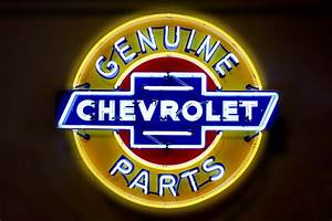Neon Genuine Chevrolet Parts Sign Photograph by Mike