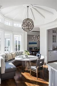 Round Breakfast Room With Gray Curved Banquette And Nixon