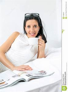 Woman Reading And Drinking Coffee On Bed Royalty Free ...