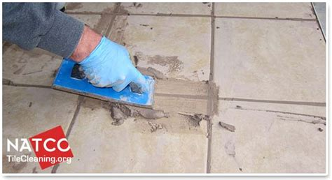 apply grout   tile floor