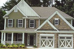 Carriage creek style 6 sandstone garage door a plus for Carriage type garage doors