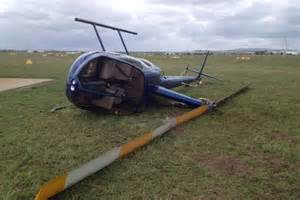 Helicopter blown over in storm at Archerfield airport ...