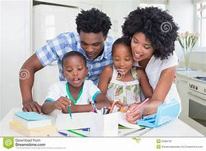 Happy Parents Helping Children With Homework Stock Photo ...