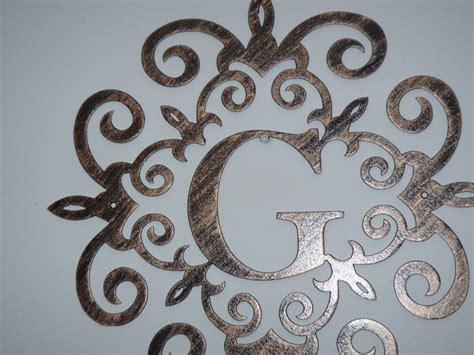 Family Initial Monogram Inside A Metal Scroll With Wall