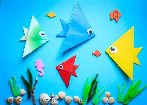 origami paper fish clan  underwater view  hand