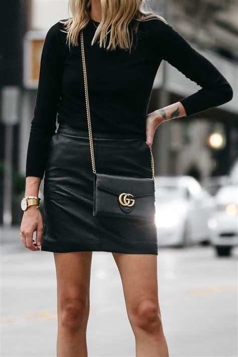 stylish   wear  black leather mini skirt fashion