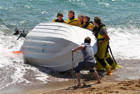The Boat Capsized by Capsized Boat Hauled Ashore By Freshwater Lifeboat