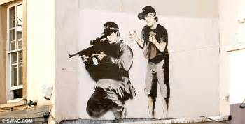famous bansky mural painted over by rival street artist in latest twist in feud daily mail online