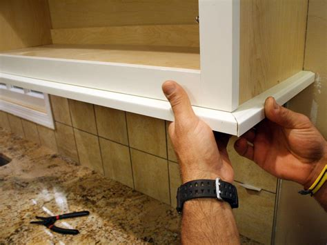 how to add molding to kitchen cabinets how to install a kitchen cabinet light rail how tos diy 9283