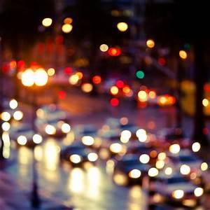 Blurry street with cars iPad wallpaper