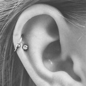 Double helix, double cartilage piercing, hoop and stud ...