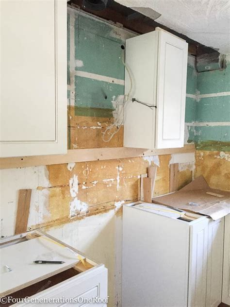 Our Kitchen Renovation Series {installing New Cabinets