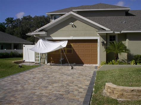 How To Paint A Metal Garage Door by Paint A Metal Garage Door To Look Like Wood Everything I