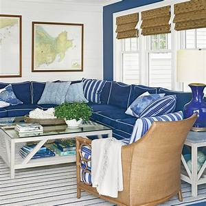 Nautical blue living room the new classic beach house for Navy blue sectional sofa with white piping
