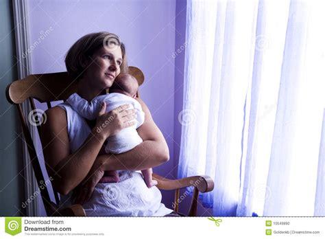 Mother Rocking Newborn Baby By Window Stock Photo Image