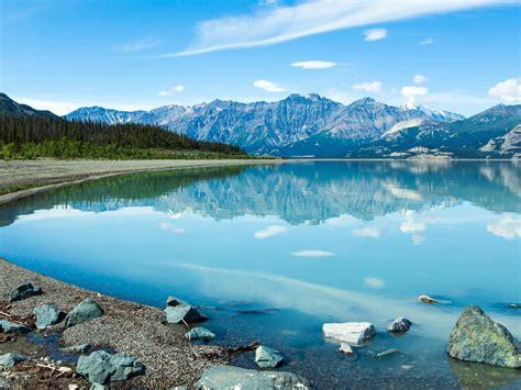 canada yukon blue lake reflection  water mountain rocks