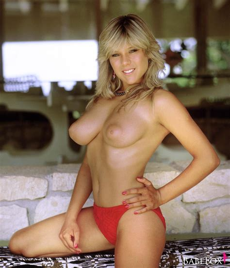 Samantha Fox Shows Her Boobs While Testing Clothes Near A Wall