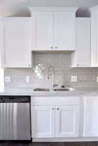 white kitchen with backsplash smoke glass subway tile grey subway tiles grey and glasses
