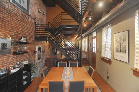 rehabbed baltimore home features exposed brick walls