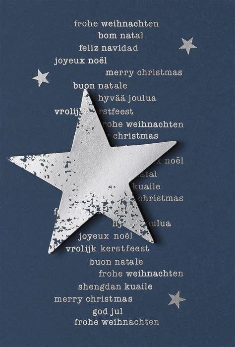 dunkelblaue weihnachtskarte mit silbernem stern und