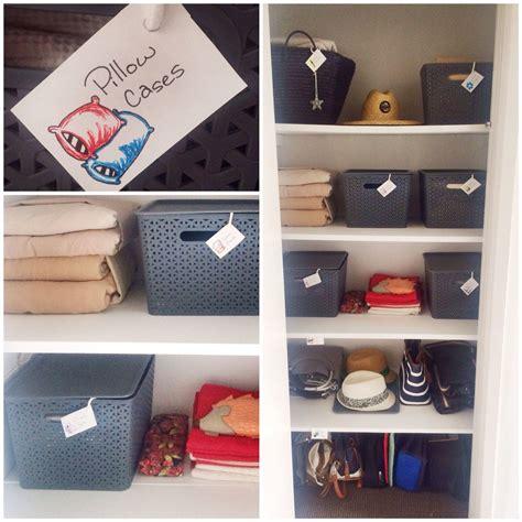 Cupboard Organization by Tidy Storage Linen Cupboard Organisation Labels Baskets