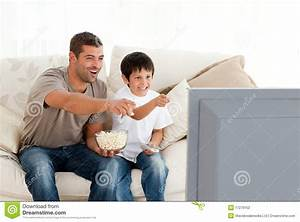 Happy Father And Son Watching Television Stock Photo ...