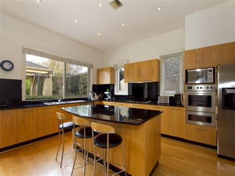 kitchen island l shaped l shaped kitchen with island railing stairs and
