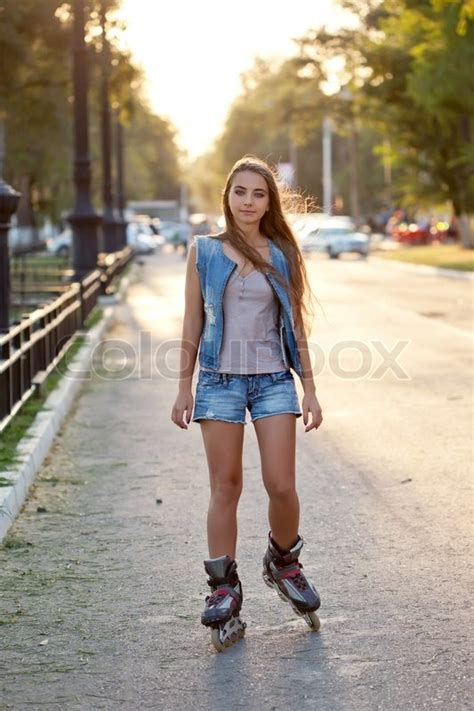 Teenager girl skating during sunset | Stock Photo | Colourbox