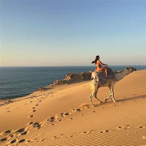 Ashley Graham Goes on Camel Ride Wearing Only a Bikini in