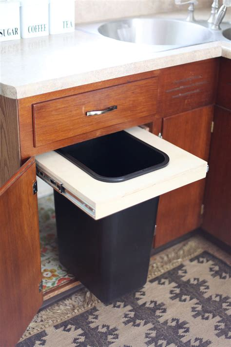 kitchen corner cabinet trash can pull out convert a cabinet into a pull out trash bin a beautiful mess