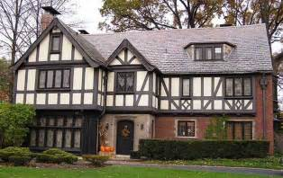 split level style tudor style homes with brick wall ideas and black