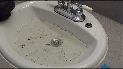 unclog  bathroom sink youtube