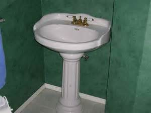 mounting a pedestal sink to the wall befon for