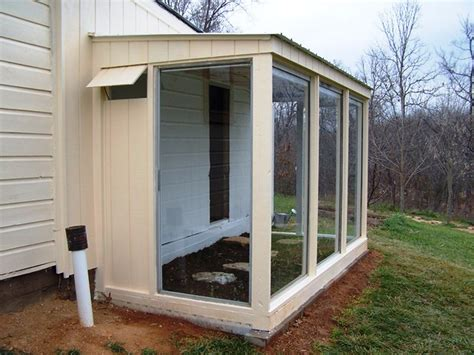 greenhouse of recycled patio doors saves money and heat