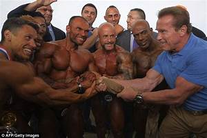 Arnold Schwarzenegger Shows Off Muscles Hosting Body Building Championship
