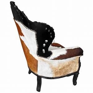 Fauteuil Peau De Vache : grand fauteuil de style baroque vrai peau de vache marron et bois noir ~ Teatrodelosmanantiales.com Idées de Décoration