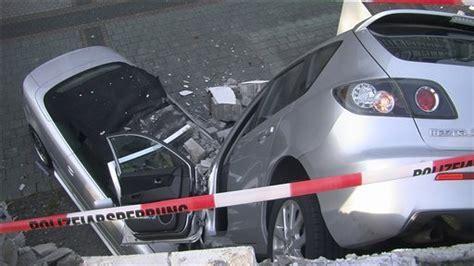 photo driver rams through parking deck wall falls 10 say