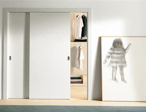 white sliding interior door for walk in closet design