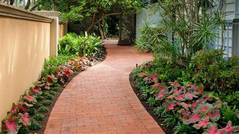 front yard pathway flanked with flowers improve your home 39 s curb appeal