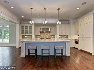 this house kitchen cabinets traditional kitchen with crown molding limestone tile in 8462