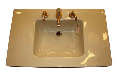 console sink yellow  sherle wagner fittings olde