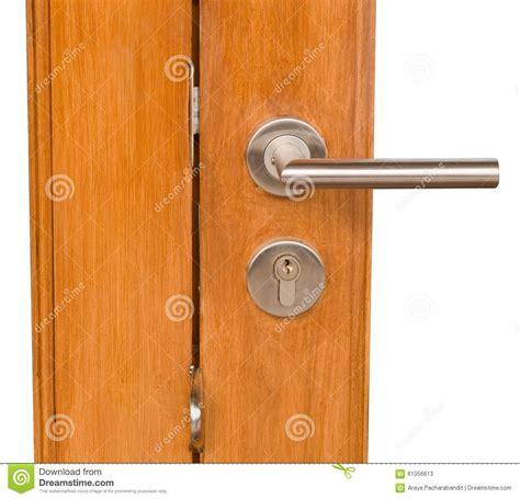 lock and door handle on golden brown wooden door stock photo image 61056613