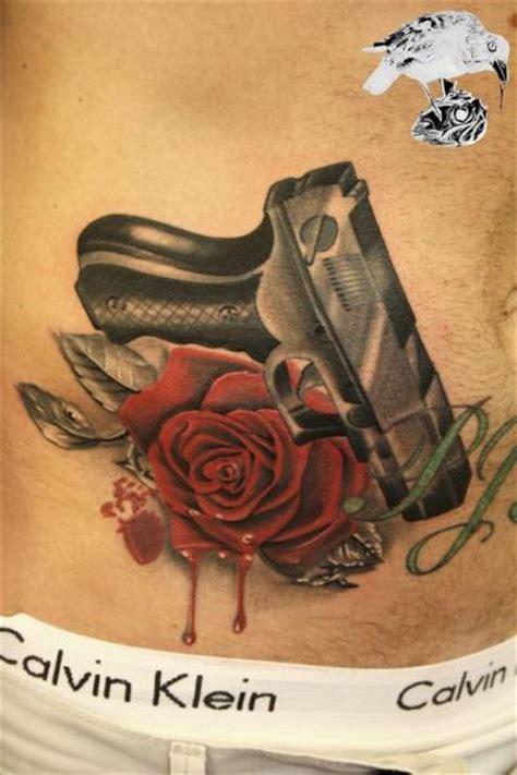 Sleeve Flower Tattoo Designs flower side gun tattoo  barry louvaine 400 x 600 · jpeg