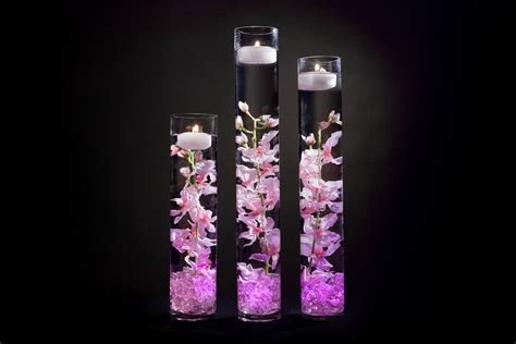 beautiful pink floral centerpieces with led lights and candles