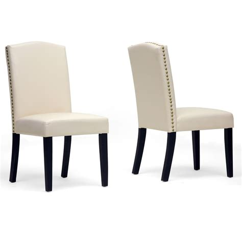 white upholstered dining chair displaying infinite