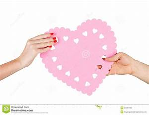 Couple In Love Holding A Heart In Their Hands Stock Photo ...