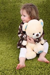 Little Girl Holding A Teddy Bear Stock Image - Image of ...