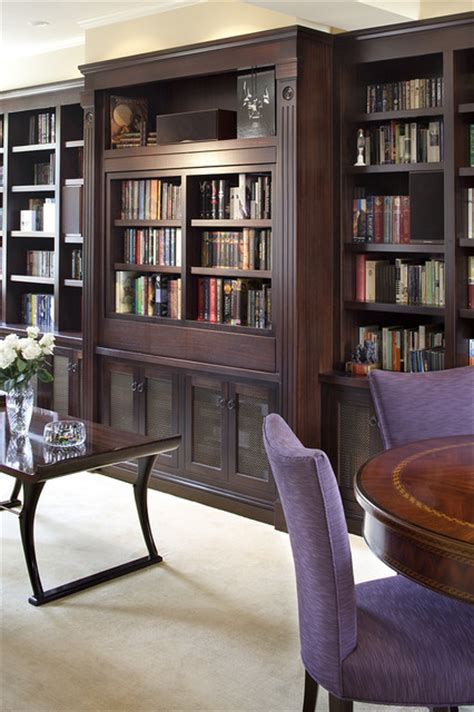 Tv Bookcases by Pivoting Tv Turning Into Bookcase Traditional Living